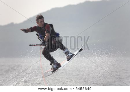 Flying Wakeboarder In Water Splash