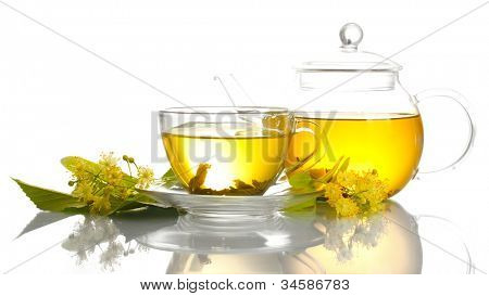 cup and teapot of linden tea and flowers isolated on white