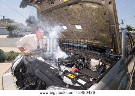 Man And His Over Heated Car