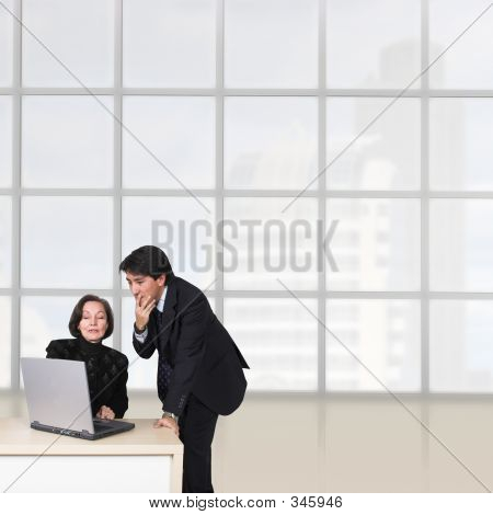 Business Couple In The Office