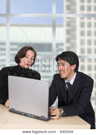 Business Couple With Laptop In The Office