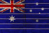 National Flag  Of Australia On A Wooden Wall Background. The Concept Of National Pride And A Symbol  poster