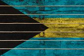 National Flag  Of Bahamas On A Wooden Wall Background. The Concept Of National Pride And A Symbol Of poster