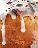 Close-up Porous Sponge Cake With White Smudges Of Glaze And Colored Sweet Confetti, Symbol Of Easter poster