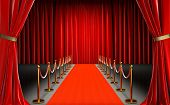 entrance of a cinema with red carpet and barriers with velvet rope, red curtains in the background a poster