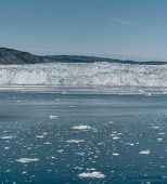 Red Passenger Cruise Ship Sailing Through The Icy Waters Of Qasigiannguit, Greenland With Eqip Sermi poster
