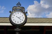 Antique Clock. Large Antique Clock At A Train Station. poster