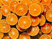 Fresh Chopped Orange Slices Food Background, Fresh Orange Color For Use In Making The Background, Or poster