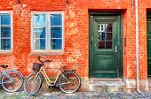 Old Red House In The Center Of Copenhagen With Bicycle. Old Medieval District In Copenhagen, Denmark poster