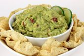 Bowl of Spicy Guacamole with Chips Closeup poster