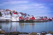 Fishing Village In Winter On The Lofoten Islands With Raspberry Houses, Early Morning, Light From Wi poster