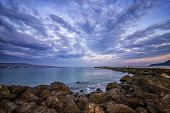 Idyllic View With Stunning Clouds Over The Sea Pier poster