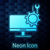 Glowing Neon Computer Monitor With Screwdriver And Wrench Icon Isolated On Brick Wall Background. Ad poster