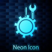 Glowing Neon Wrench And Screwdriver In Gear Icon Isolated On Brick Wall Background. Adjusting, Servi poster
