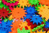 The Childrens Designer. Colored Plastic Blocks Of The Designer On The Table. Childrens Designer For  poster