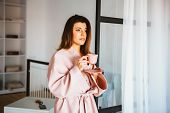 Beautiful Girl In A Bathrobe Enjoying Coffee At Home. Drinks Morning Coffee, Good Morning.morning Co poster