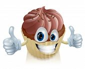 stock photo of whip-hand  - A happy chocolate cupcake mascot smiling with a double thumbs up - JPG
