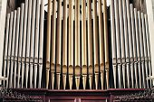 picture of pipe organ  - Church organ with golden and silver tube pipes - JPG