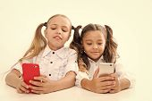 Modern Students. Small Students Using Mobile Phones In Classroom Isolated On White. Little Students  poster