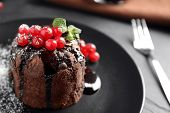 Delicious Warm Chocolate Lava Cake With Mint And Berries On Table, Closeup. Space For Text poster
