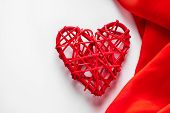 Red Hearts And Silk Ribbon On A White Background. One Red Heart And A Silk Ribbon Frame On A White B poster