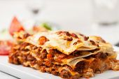 pic of lasagna  - closeup of italian lasagna on a square plate - JPG