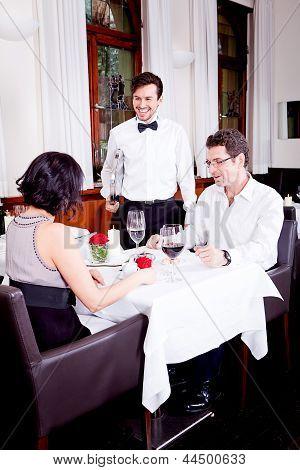 Waiter Serve Fresh Espresso For Happy Couple