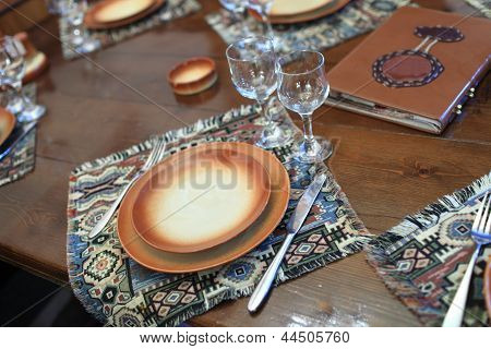 Empty Brown Plate On Wooden Table
