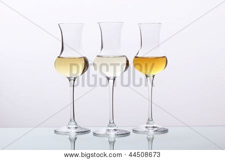 cocktail three glass on gray background