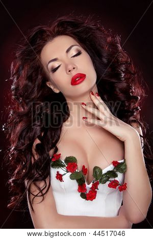 Hot Red Lips. Portrait Of Sexy Brunette Girl With Professional Make-up And Hairstyle Over Dark Backg