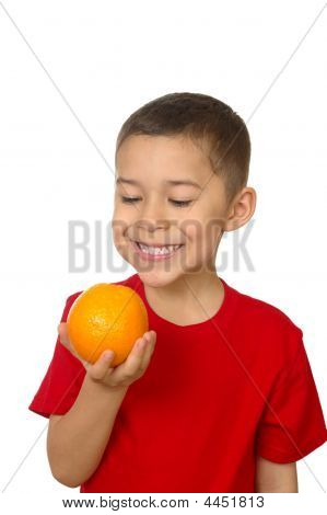 Seven-year-old Boy Smiling Holding An Orange