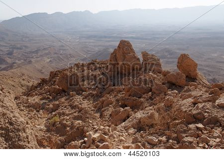 Jagged rocks at the rim of desert canyon in the Small Crater (Makhtesh Katan) in Negev desert Israel