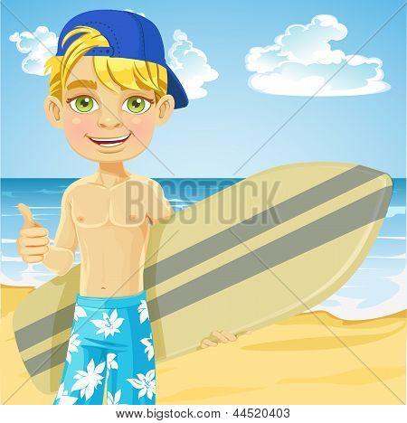 Cute teen boy with a surfboard on a sunny beach