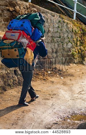 Indian Porter Carrying Heavy Bags Manual Labor