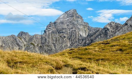 Impressive Alpine Peak With Yellow Grass