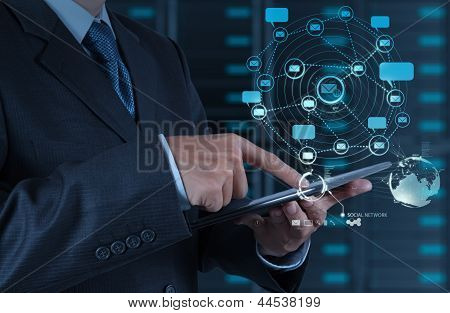 Businessman Using Tablet Computer Shows Internet And Social Network