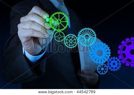 Businessman Hand Draw Leader Cog Gear To Success