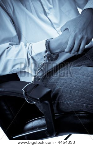 A Businessman Handcuffed