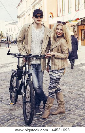 Caucasian couple with bicycle