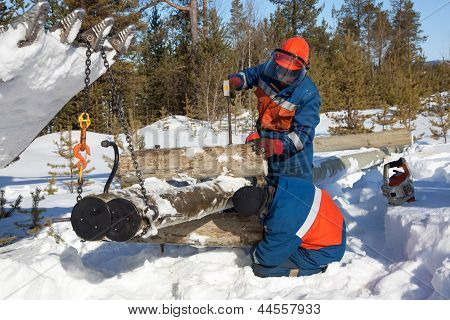 Installers Collect A Power Pole In The Snow