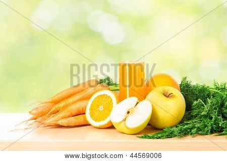 Fruit And Vegetable Juice In Glass Over Green Fresh Background. Healthy Vitamin Food Diet Concept.
