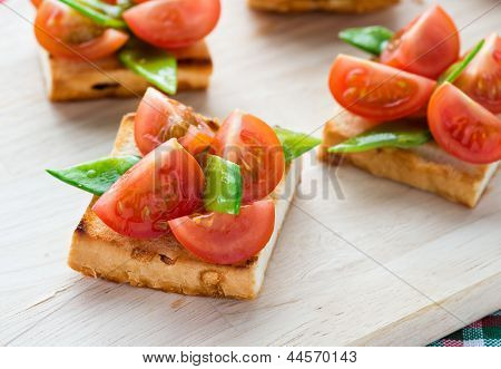 Bruschetta with fresh tomato and snow peas