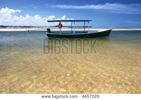 Boat In Crystalline Clear Sea In Brazil