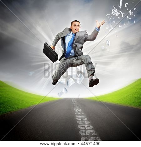 Businessman running on the road
