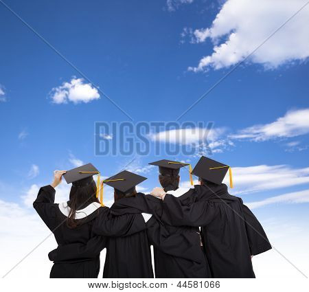 Four Graduate Students Looking At Sky