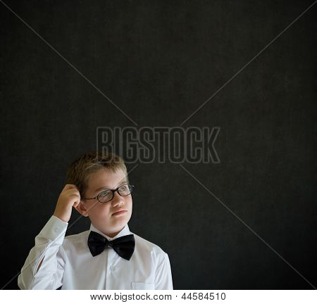Scratching Head Thinking Boy Dressed Up As Business Man