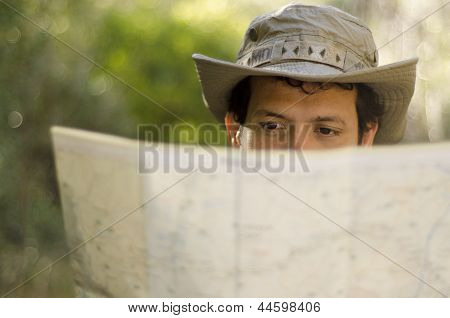 Young man looking at a map