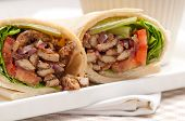 stock photo of sandwich wrap  - kafta shawarma chicken pita wrap roll sandwich traditional arab mid east food