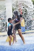 Family Having Fun In Water Park