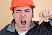 stock photo of pissed off  - This construction worker is pointing and yelling his head off at someone - JPG
